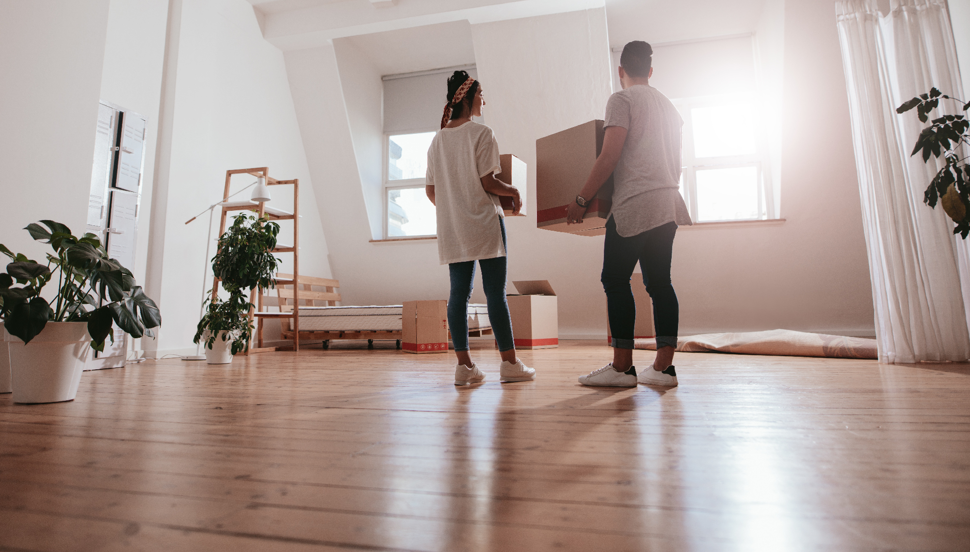 Couple moving holding moving box