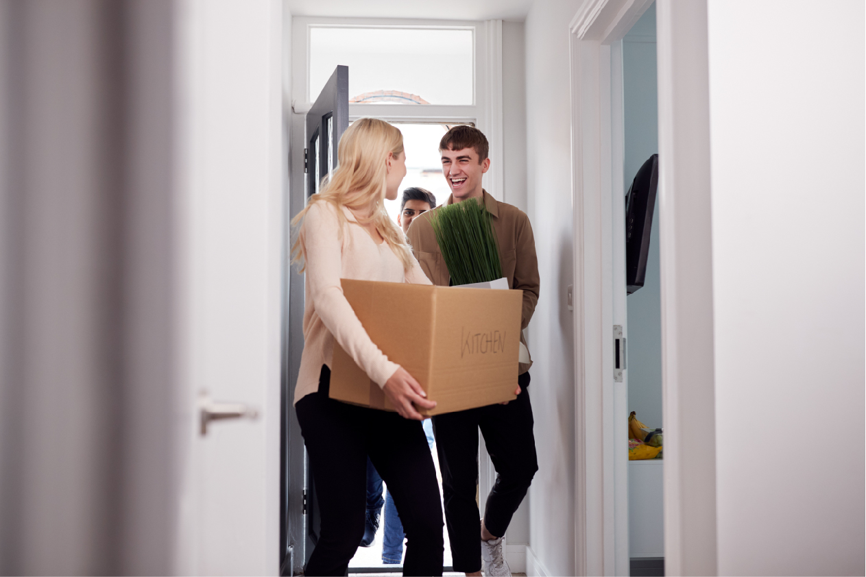 young adults moving into apartment